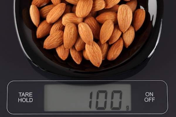 Digital scale weighing almonds.