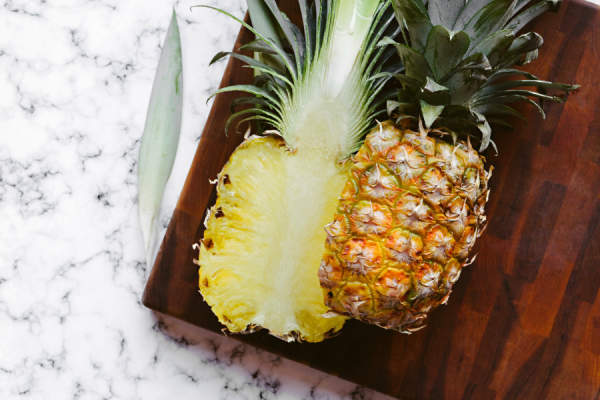 pineapple cut in half on marble