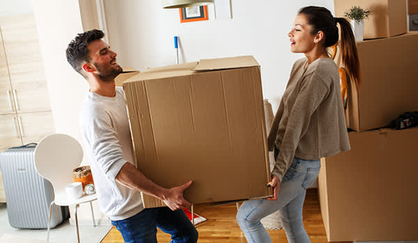 couple moving large box image