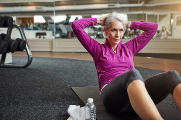 Older woman doing sit-ups
