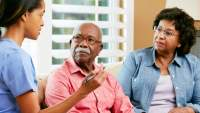 older couple talking with therapist