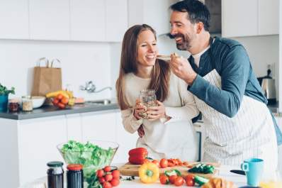 Couple cooking together.