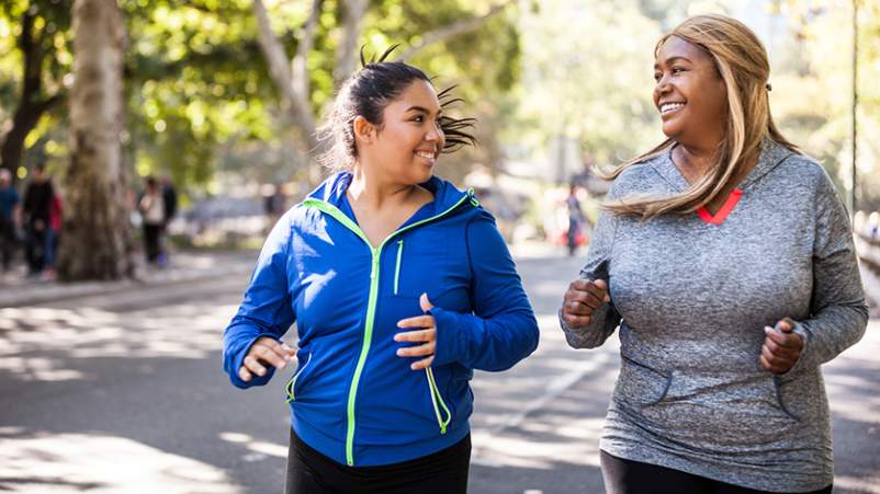 Women jogging together in a park.