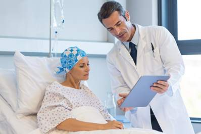 Doctor showing tablet to a breast cancer patient.