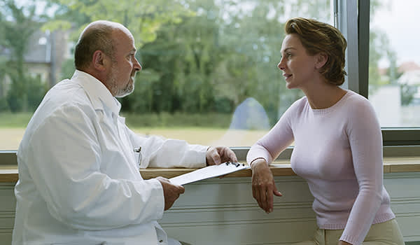 Doctor discussing information with a patient.
