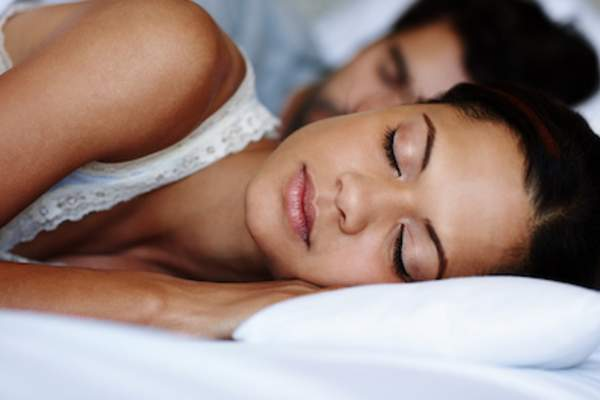 Woman and man sleeping soundly.