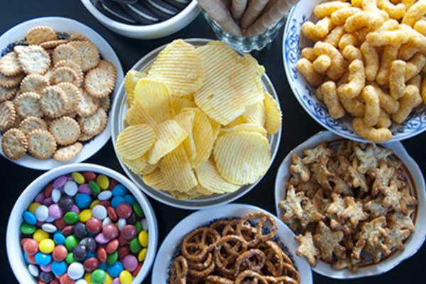 Junk snack foods in bowls.