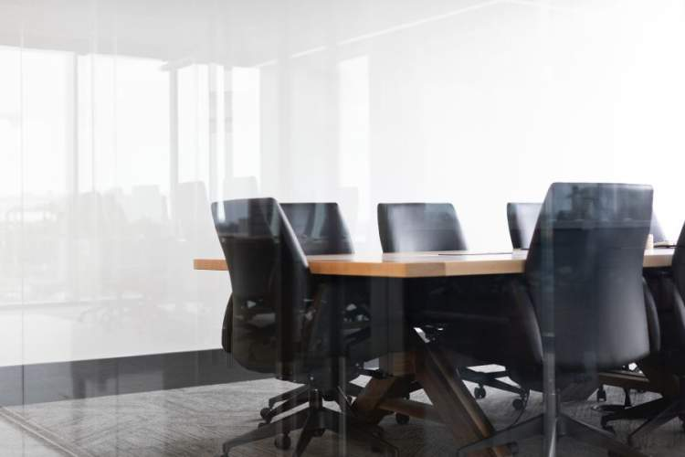 chairs around conference table