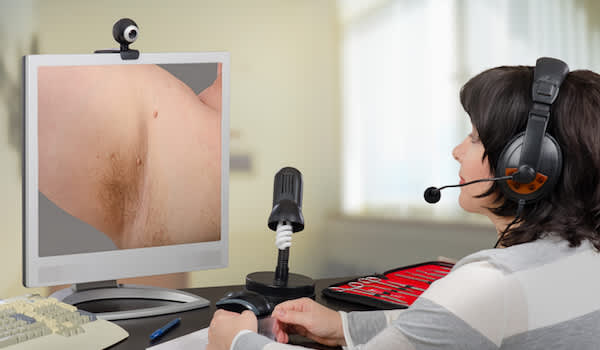 Telemedicine dermatologist looking skin tags, on computer monitor.
