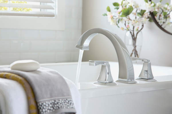 Water flowing from faucet into bathtub