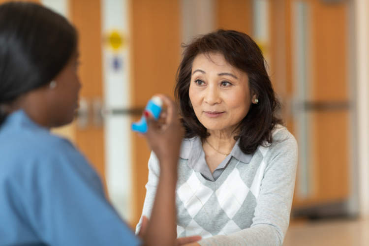 patient meeting with doctor showing inhaler
