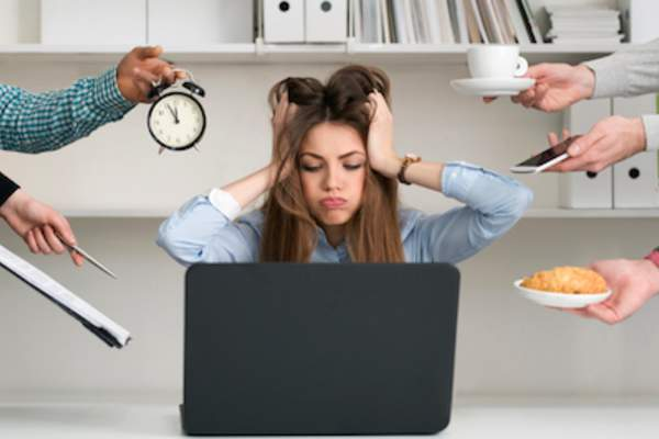 Woman under high stress, from work and life.