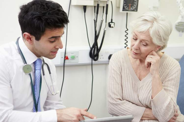woman reviewing check up chart with doctor