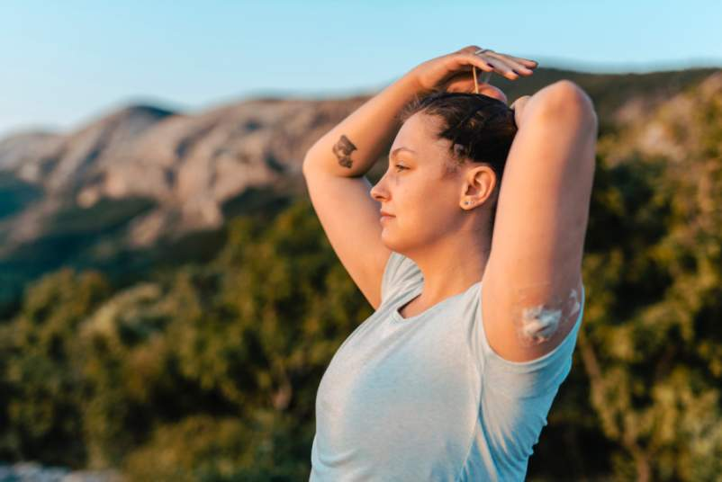 woman with insulin pump exercising in nature