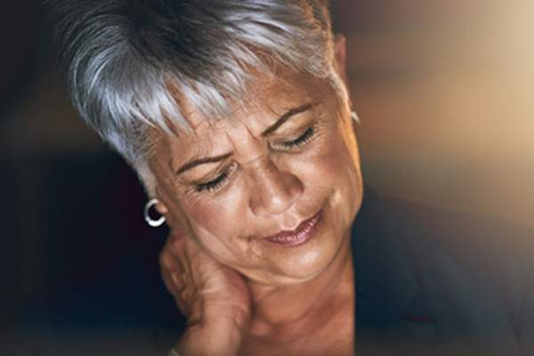 Middle age woman with neck pain.