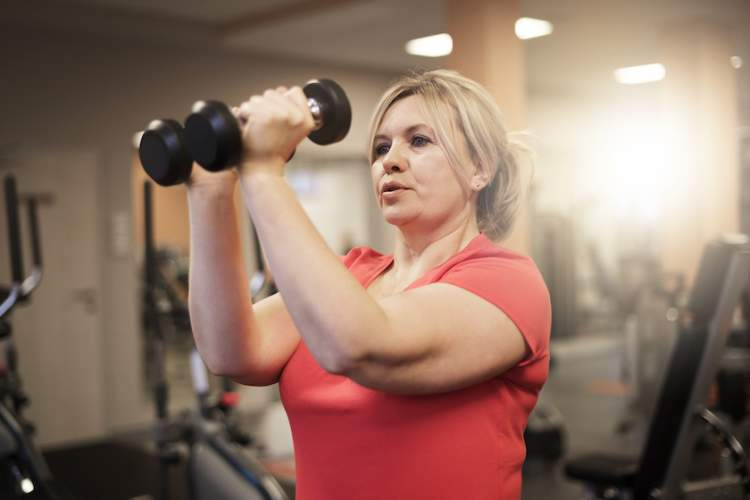 Woman exercising at gym.