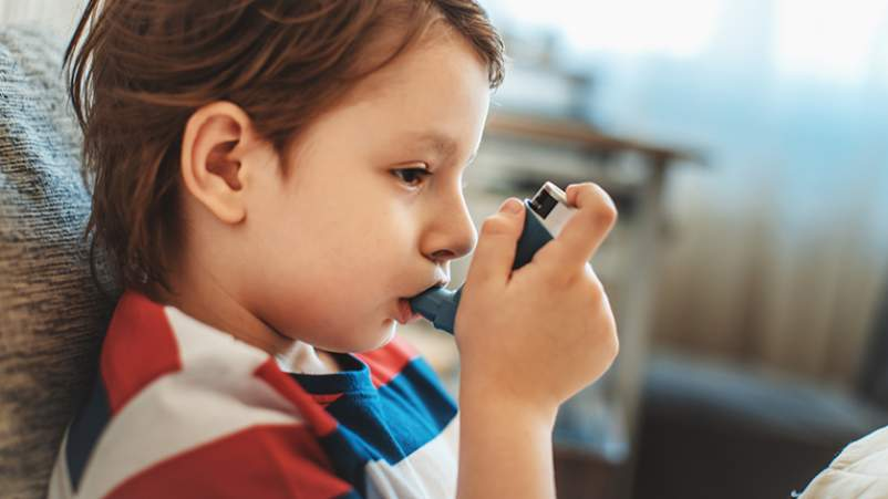 Child using an inhaler.