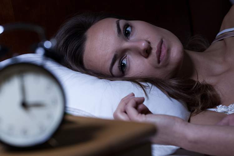 Woman with insomnia in the middle of the night image.
