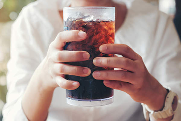 Glass of dark-colored soda.
