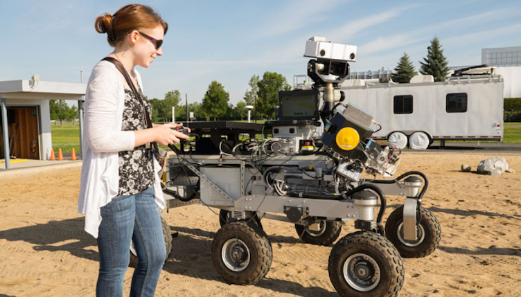 "Tanya driving the Canadian Space Agency's (CSA) Mars Exploration Science Rover (MESR) at the CSA ""Mars Yard"" near Montreal."