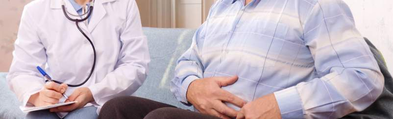 man talking with doctor about IBS diagnosis and other stomach issues