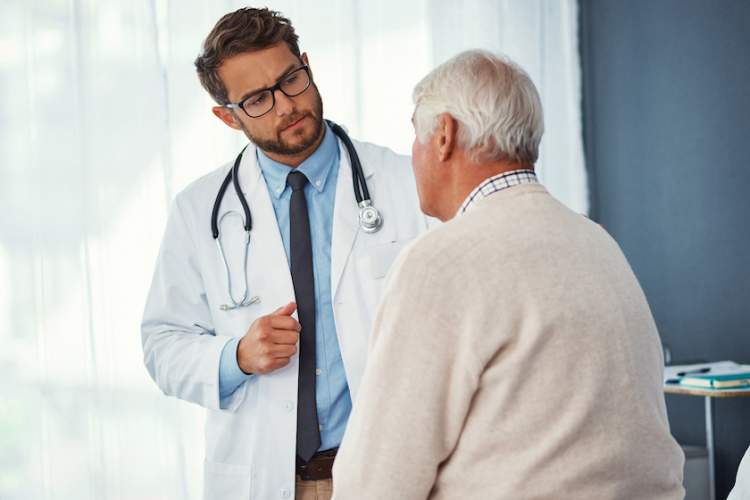 Doctor talking to male patient.