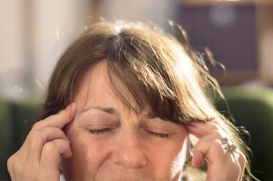 Woman having migraine with aura.