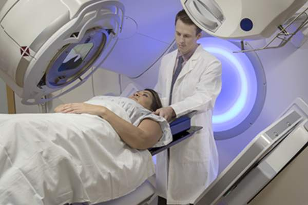 Woman receiving radiation therapy,