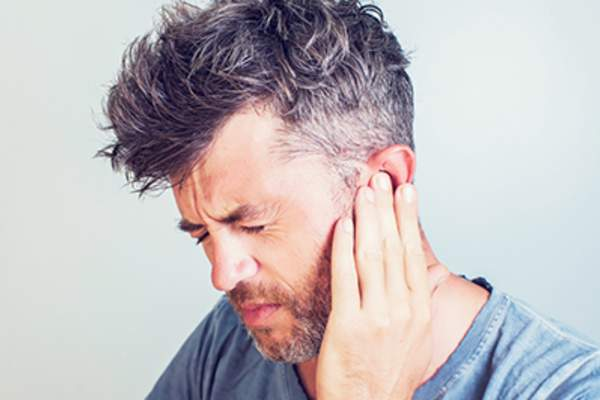 Man with ear pain.