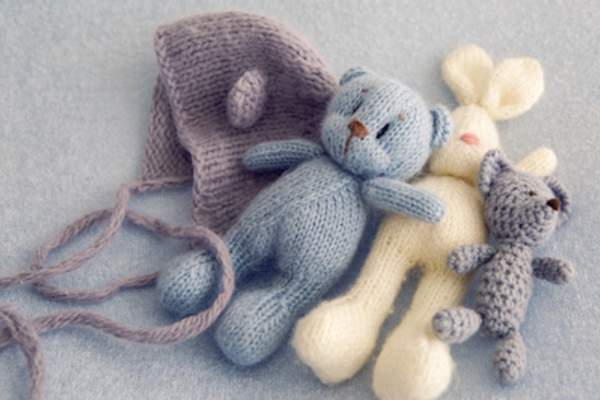 Handcrafted knitted cap and stuffed toys.