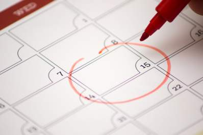 Marking date on calendar to track cycle.