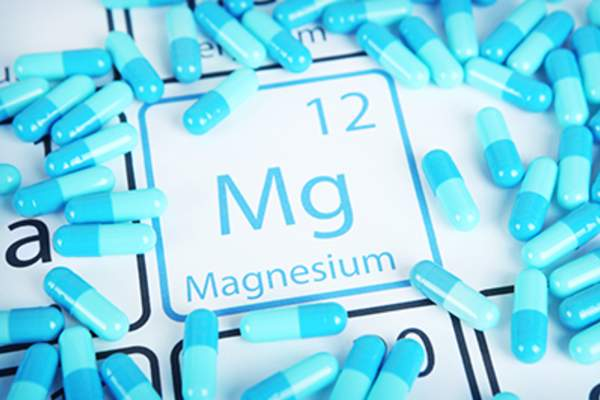 Magnesium supplements on a periodic table of elements.
