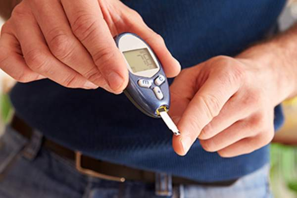 Diabetic man checking his blood sugar levels.