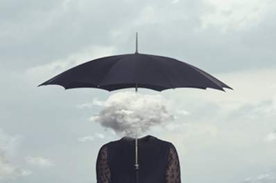 A woman with brain fog clouds around her head.