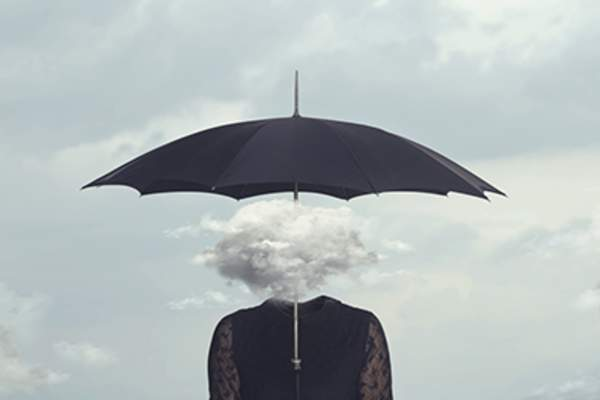 Woman with a cloud in place of her head.