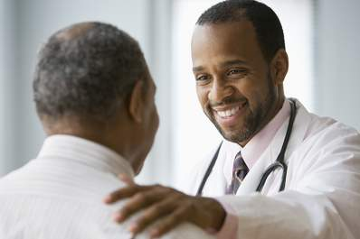Oncologist smiling at a patient.