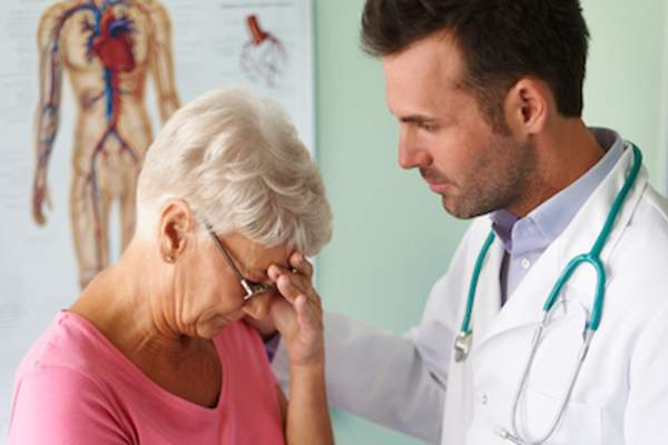 Older patient talking to doctor about feelings of sadness