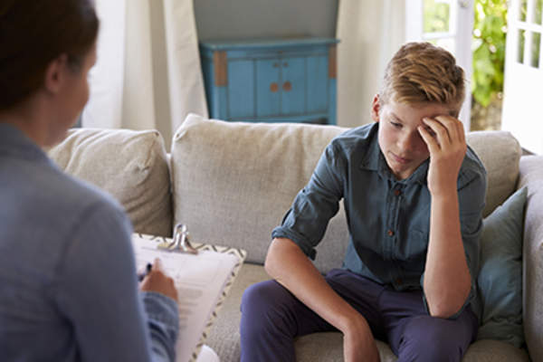 Boy talking to a mental health counselor.
