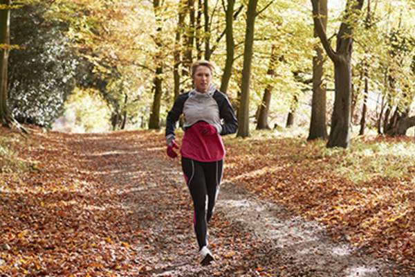 Woman on a run in Autumn.