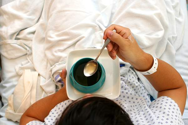hospital patient drinking coffee image