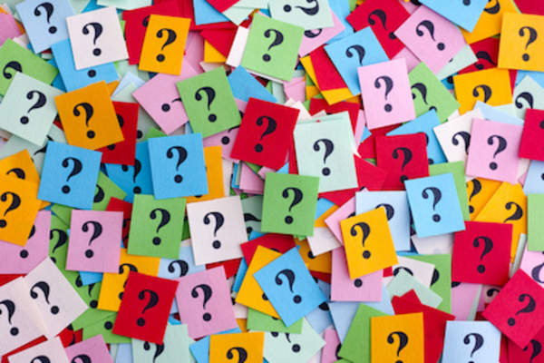 Multitude of question marks on colorful squares.