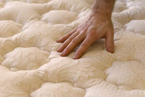 Buying bed mattress, checking firmness.