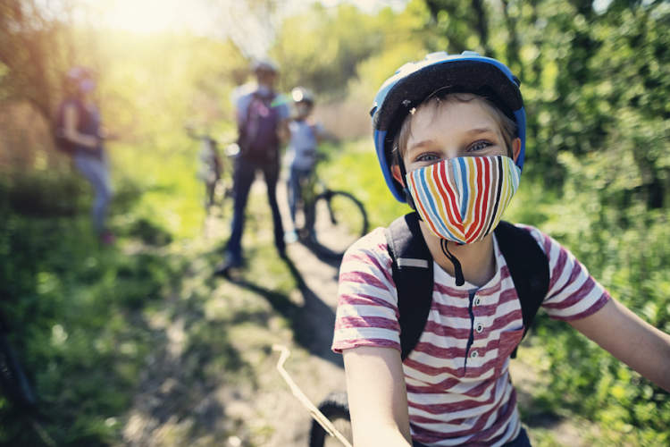 kid biking COVID-19 mask