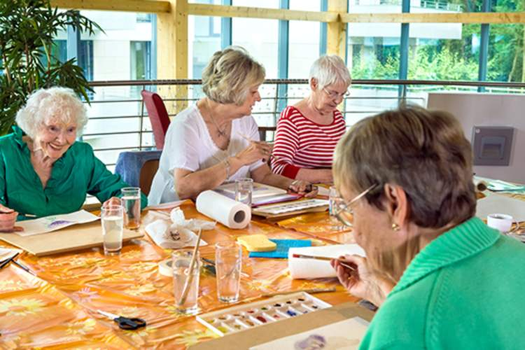 Painting class in nursing home rec room image.