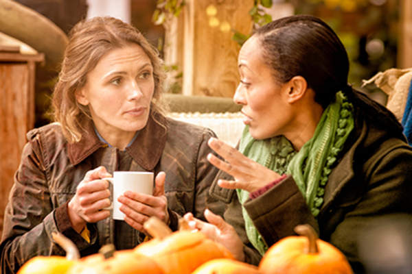 Women talking at a coffee shop.