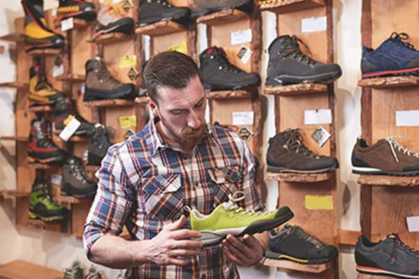 Man shopping for new running shoes