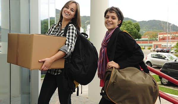 Young women moving into college residence hall image.