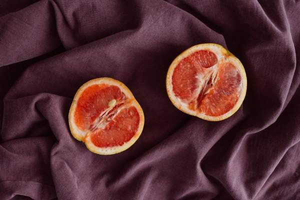 two halved grapefruits on silk