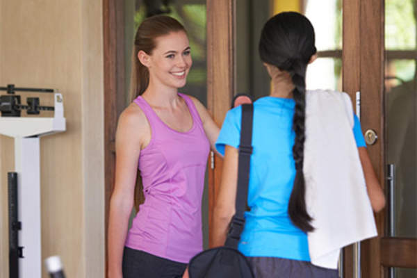 Young woman leaving the gym.