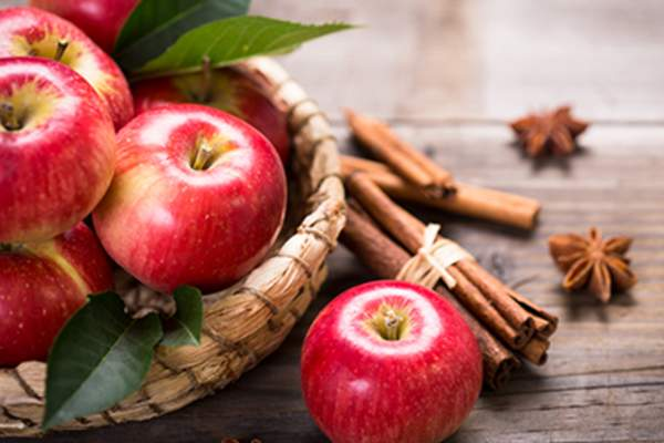 Red apples and cinnamon.